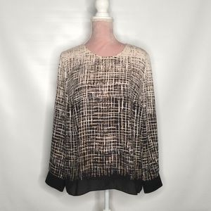 Vince Camuto top with geometrical pattern.